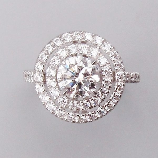 Bague double entourage diamants